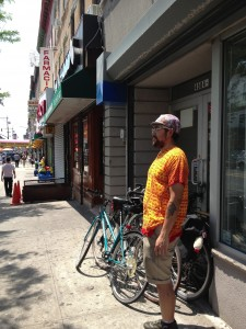 A Bike Commuter Stands